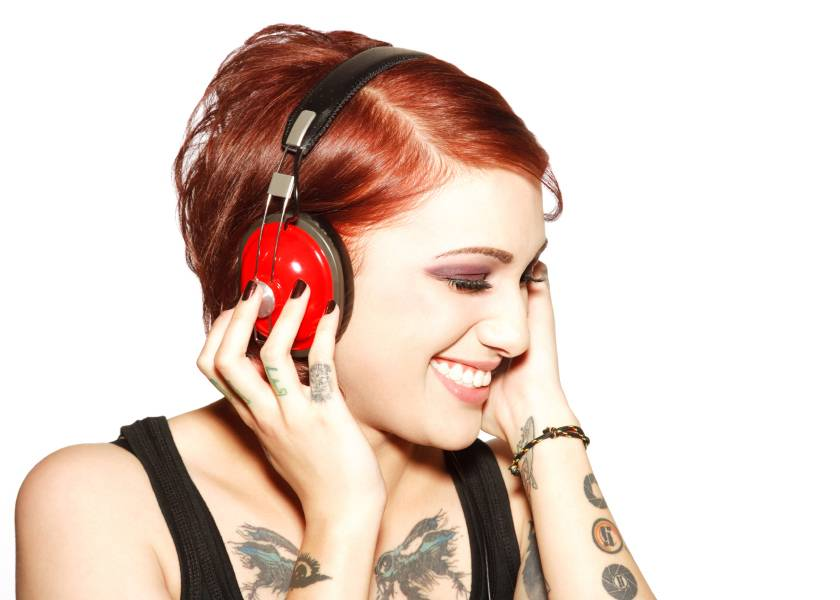 Woman listening to red headphones